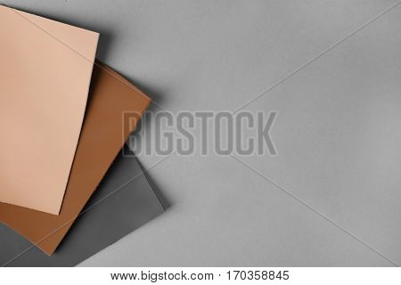Examples of leather on gray background