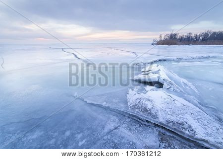 winter dawn on the river / bright photograph of a winter landscape Ukraine