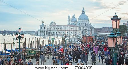 VENICE, ITALY - FEBRUARY 27, 2016: People in St. Mark's Square during the Venetian Carnival mask in Venice, Italy on February 2016.