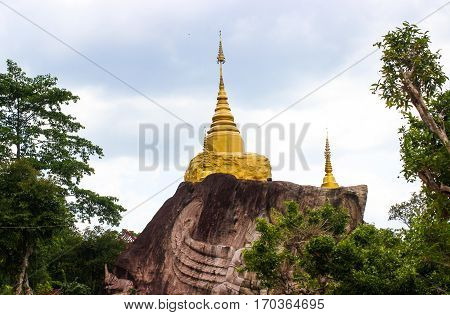 Temple at Sakonnakhon province in Thailand which graven stone Mountain.
