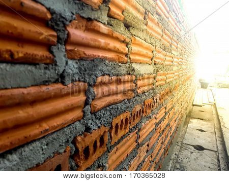 Background of brick wall texture  of industrial bricklayer installing bricks on construction site