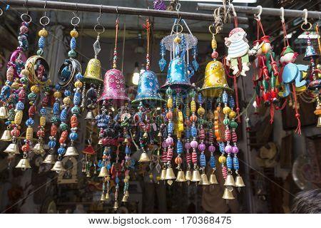 gift hanging display at shopfront of marketplace in Pushkar city Rajasthan India.