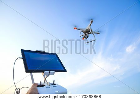 Quadrocopters And A Remote Control For It. Quadrocopters Against The Blue Sky. Umravlenie Quadrocopt