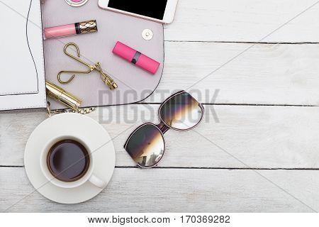 beautiful decorative cosmetics:lip gloss, nail polish, lipstick, eye shadow, pink