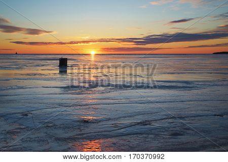 Ice fishing shack at sunset along the shores of rural Prince Edward Island.