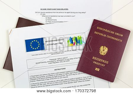 MUNICH, GERMANY- OCTOBER 2016: Austrian passport on EU complaint form in Munich, Germany on October 23, 2016. Passengers complain airline concerned with denied boarding downgrading cancellation delay