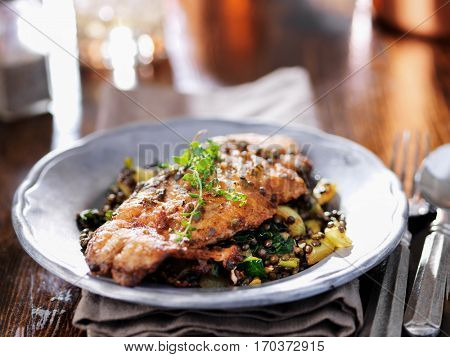 fried catfish on black lentils with capers and thyme