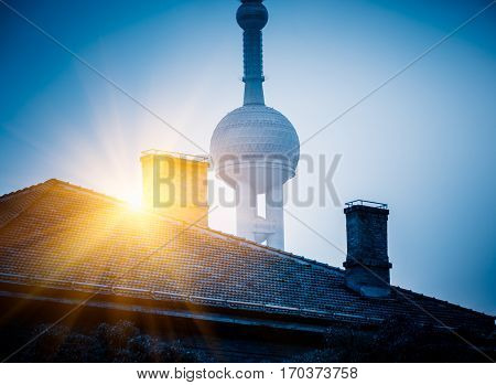 vintage house with part of oriental pearl tower in backgroundcity skyline in China.