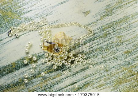 Pendant In Seashell Among Scattered Pearls.