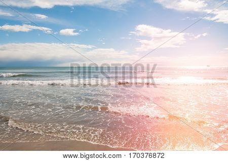 Beautiful beach with waves and ocean and light leak