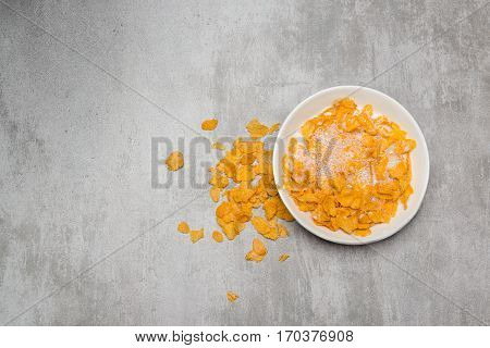 Corn Flakes With Milk In A Bowl On A Concrete Table