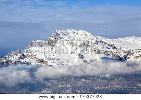 Beautiful rocky mountain peak covered by snow over a ski in the Alps in Mont Blanc Massif.