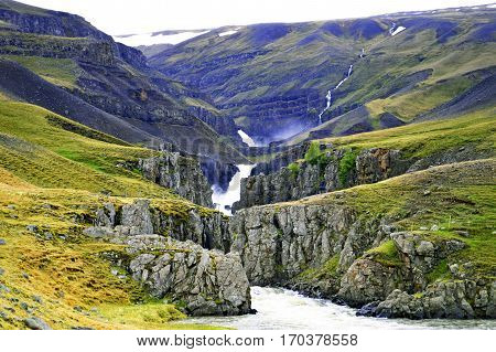 Mountain valley with river in the Faroe Islands
