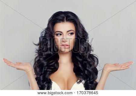 Beautiful Woman Showing her Empty Hands. Difficult Choice Concept