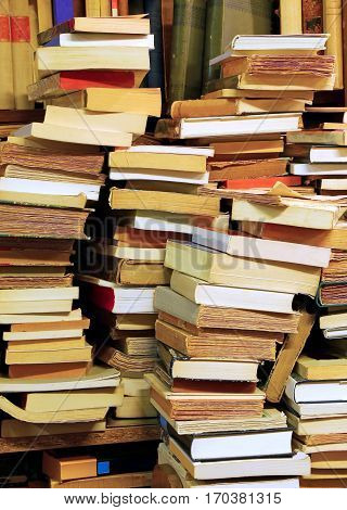 many piles of old books for sale