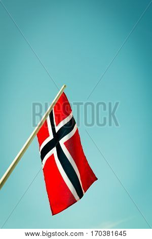 Norwegian flag waving with the sky as the background