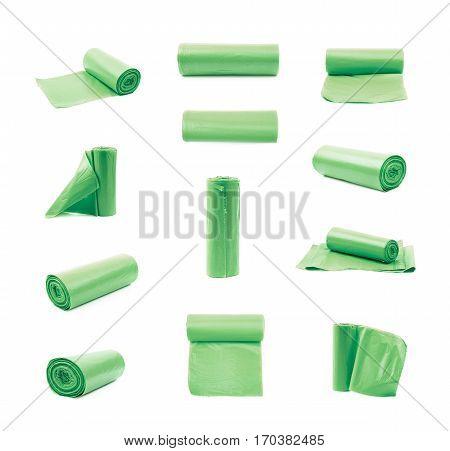 Green plastic polyethylene trash bag roll isolated over the white background, set of multiple different foreshortenings