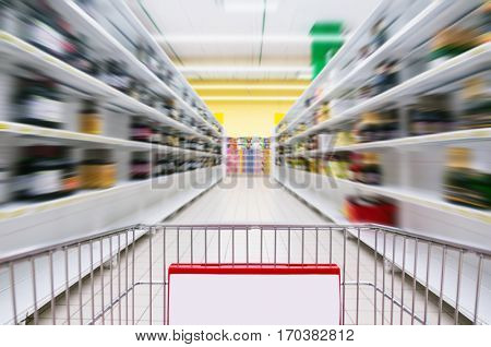 Shopping Cart View on a Supermarket Aisle and Shelves - Image Has Shallow Depth of Field