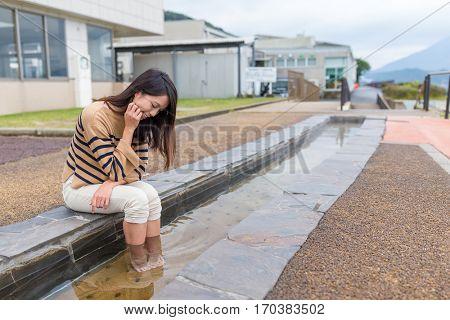 Woman enjoy foot onsen at kagoshima