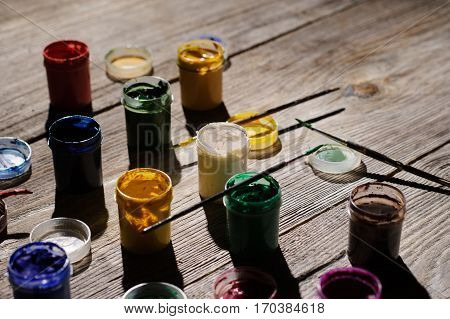 Paint And Brushes On The Wooden Background