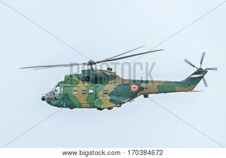 Puma Helicopter Pilots Training In The Blue Sky, Side View.