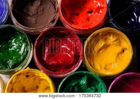 different colour paint in bottles closeup many colours