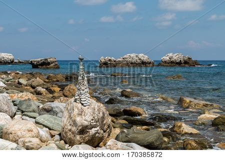 Rocky beach with a stack of pebbles arranged into an environmental statue