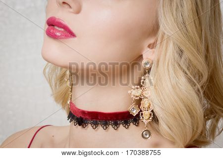 Beautiful Woman Showing Her Neck With A Choker On It