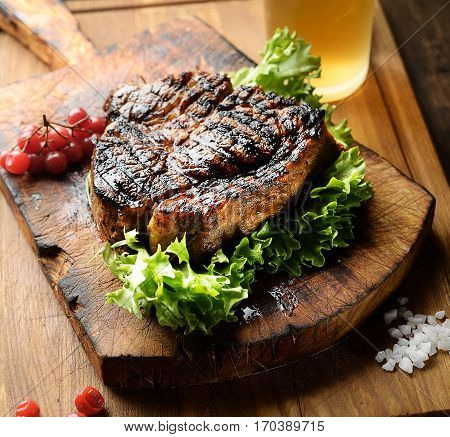 juicy grilled steak with spices on a cutting board
