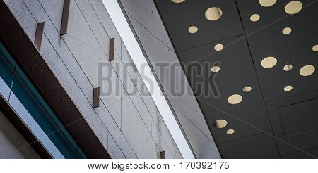 Architectural features lines and circles in building facade and awning