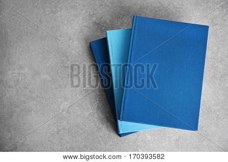 New hardcover books on gray background