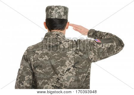 Soldier in camouflage saluting on white background