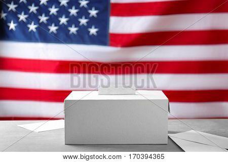 Ballot box and envelopes on USA national flag background