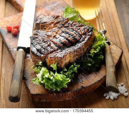 juicy grilled steak with spices on a cutting board.