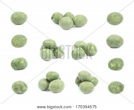 Green wasabi coated peanuts isolated over the white background, set of multiple different foreshortenings