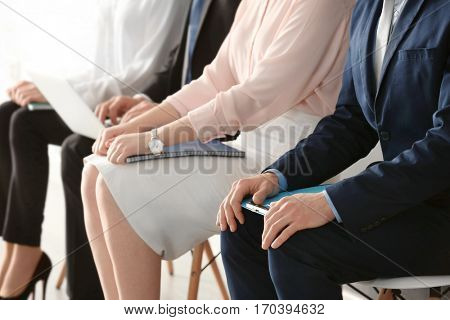 Group of people waiting for job interview indoors