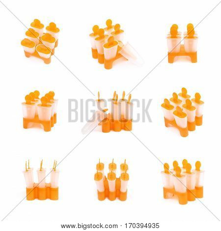 Plastic orange popsicle ice lolly form molds set isolated over the white background, set of nine different foreshortenings