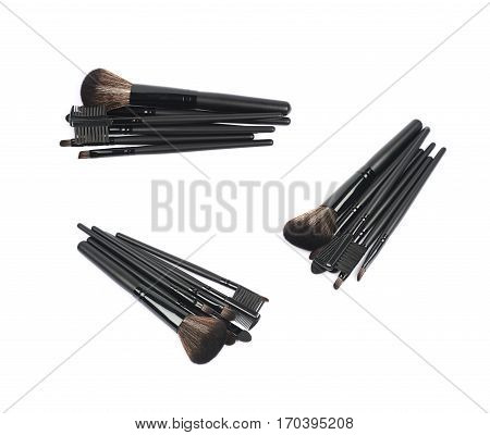 Pile of multiple black makeup tools and brushed isolated over the white background set of three different foreshortenings