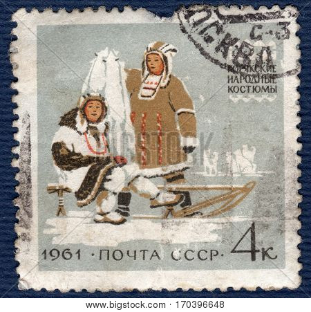 USSR - CIRCA 1961: Postage stamp printed in the USSR  with a picture women and a man in koryak folk costumes,  from the series