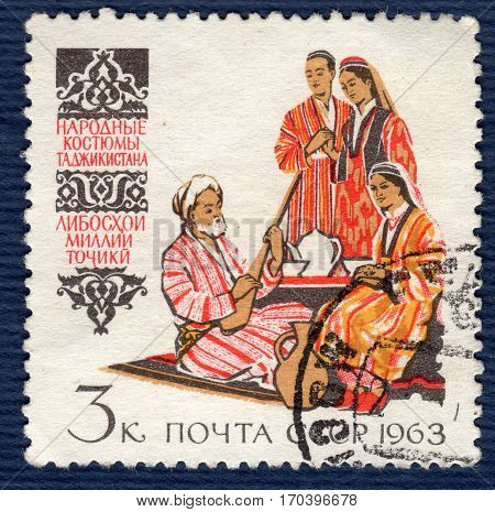 USSR - CIRCA 1963: Postage stamp printed in USSR shows image of musicians and dancers in traditional and historic regional costumes Tajikistan , from the series
