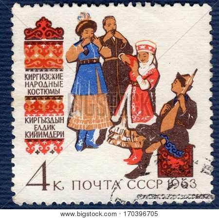 USSR - CIRCA 1963: Postage stamp printed in USSR shows image of musicians and dancers in Kyrghyz  traditional and historic regional costumes, from the series