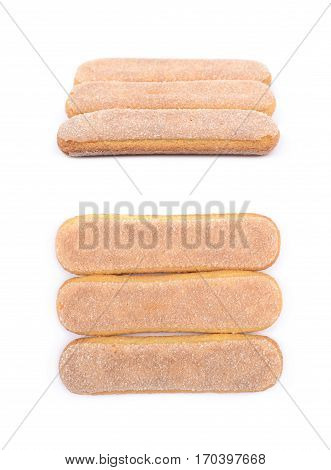 Ladyfinger savoiardi biscuit cookies lined up, composition isolated over the white background, set of two different foreshortenings