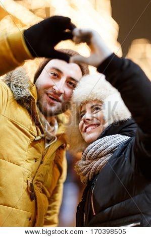 Enamoured people on romantic winter walk through city