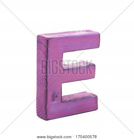 Single sawn wooden letter E symbol coated with paint isolated over the white background