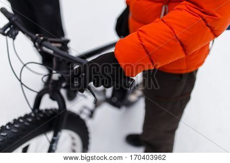 Man next to bicycle in winter park