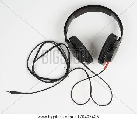 Closed back black stereo headphones on white background
