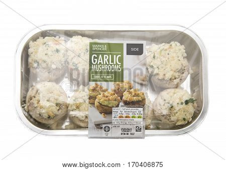 SWINDON UK - JANUARY 1 2017: Marks and Spencer Garlic Mushrooms on a white background