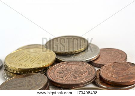 Financial background with different coins on the white.