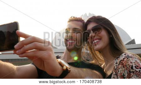 Couple taking a selfie in Lotus Temple (Baha'i Temple) in Delhi, India