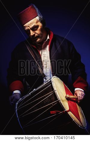 Musician With Fez And Tapan Drum